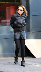 Former Spice Girl Geri Halliwell wearing a black puffa jacket, and leather shorts with black ankle boots out and about in London, UK. 30/01/2013<br />