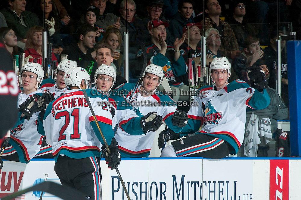 KELOWNA, CANADA - FEBRUARY 18: Devante Stephens #21 of the Kelowna Rockets skates by the bench to celebrate a second period goal against the Prince George Cougars on February 18, 2017 at Prospera Place in Kelowna, British Columbia, Canada.  (Photo by Marissa Baecker/Shoot the Breeze)  *** Local Caption ***