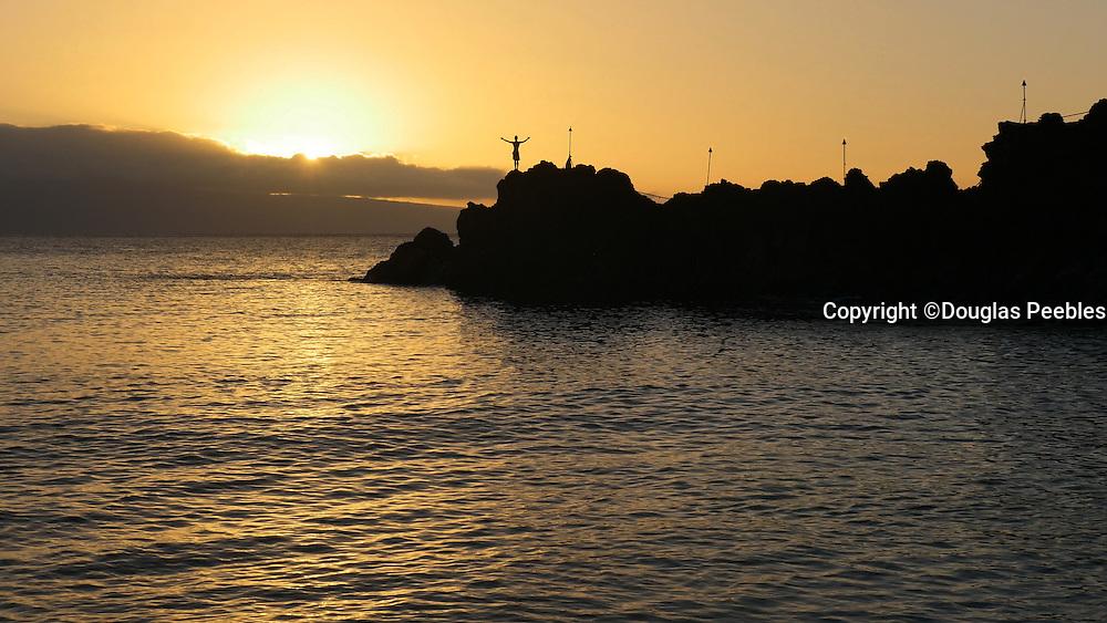Cliff dive at sunset,Kaanapali Beach, Maui, Hawaii