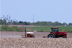 12 May 2009: A farmer leaves a cloud of dust behind his tractor while pulling a planter.