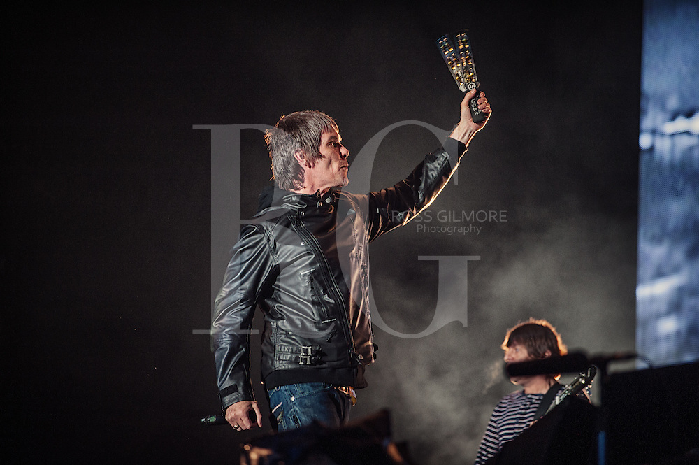 KINROSS, UNITED KINGDOM - JULY 07: Ian Brown of The Stone Roses performs on stage during T In The Park Festival at Balado on July 7, 2012 in Kinross, United Kingdom. (Photo by Ross Gilmore
