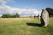 Avebury is a Neolithic henge monument containing three stone circles, around the village of Avebury in Wiltshire, in southwest England. One of the best known prehistoric sites in Britain, it contains the largest stone circle in Europe. It is both a tourist attraction and a place of religious importance to contemporary Pagans.