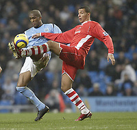 Photo: Aidan Ellis.<br /> Manchester City v Charlton Athletic. The Barclays Premiership. 12/02/2006.<br /> City's Sylvain Distin and Charlton's Talal El Karkouri go for the ball