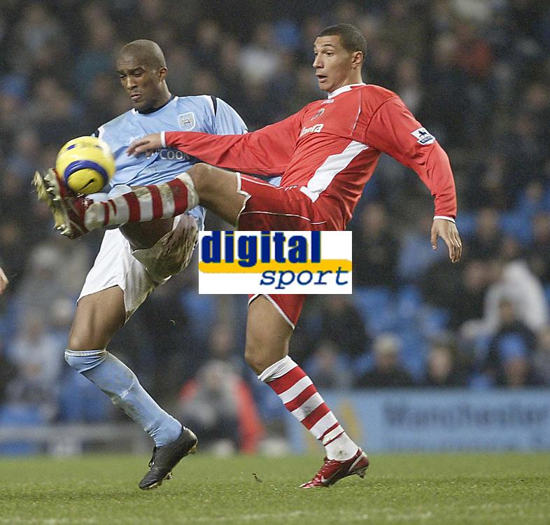 Photo: Aidan Ellis.<br /> Manchester City v Charlton Athletic. The Barclays Premiership. 12/02/2006.<br /> City's Sylvain Distin and Charlton's Talal El Karkouri go for the ball
