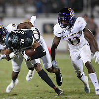 ORLANDO, FL - OCTOBER 14: Rowe Mellott #12 of the East Carolina Pirates and Davondre Robinson #13 of the East Carolina Pirates tackle Cam Stewart #11 of the UCF Knights during a NCAA football game between the East Carolina Pirates and the UCF Knights at Spectrum Stadium on October 14, 2017 in Orlando, Florida. (Photo by Alex Menendez/Getty Images)