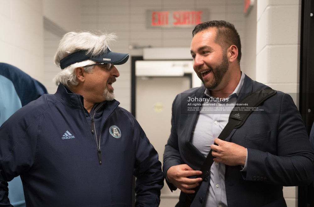Toronto Argonauts general manager Jim Popp and asst. general manager Spencer Zimmerman in the locker room after the win against the Hamilton Tiger-Cats at Tim Horton's Field in Hamilton, ON, Saturday, September 30, 2017. (Photo: Johany Jutras)