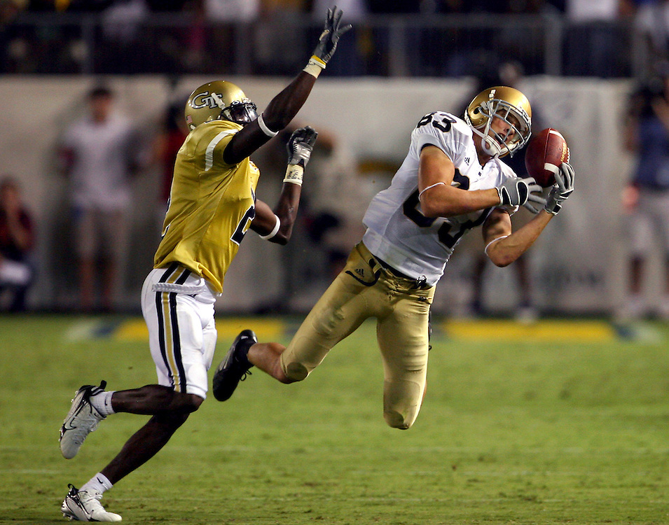 Sep. 2, 2006; Atlanta, GA, USA; Notre Dame Fighting Irish wide receiver (83) Jeff Samardzija catches a pass in front of Georgia Tech Yellow Jackets cornerback (2) Kenny Scott in the fourth quarter. Notre Dame won 14-10. Mandatory Credit: Matt Cashore-US PRESSWIRE © copyright (2006) Matt Cashore