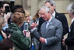 © Licensed to London News Pictures . 14/05/2015 . Liverpool , UK . The Prince of Wales talks to the crowd and poses for photos outside as he leaves a visit with the Duchess of Cornwall to the World Museum in Liverpool . Photo credit : Joel Goodman/LNP