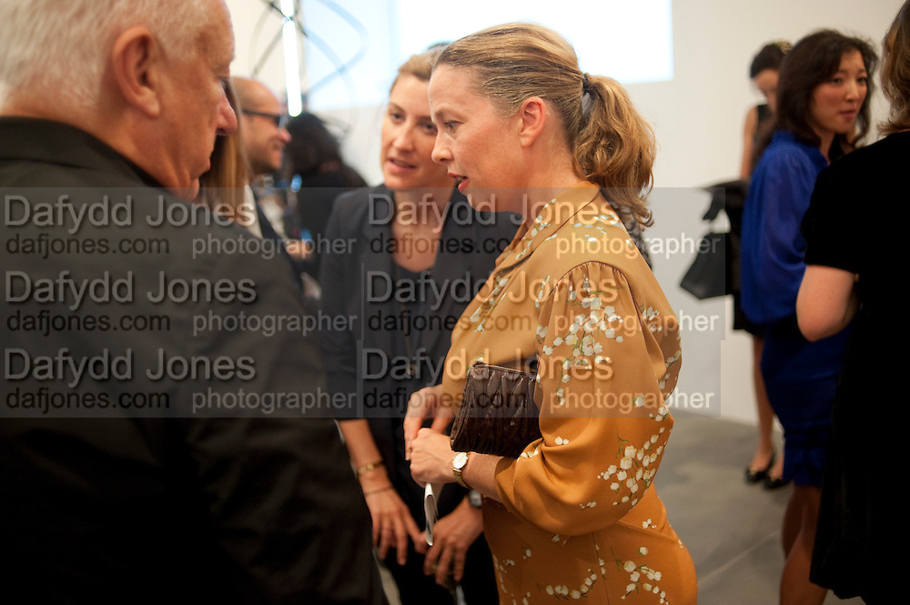 MICHAEL CRAIG-MARTIN; GEORGINA COHEN; JENNY SAVILE, Artists for Women for Women International, A PRIVATE VIEW AND LAUNCH RECEPTION OF LEADING CONTEMPORARY ARTISTS WHO HAVE DONATED WORKS TO BE AUCTIONED AT CHRISTIEÕS POST-WAR AND CONTEMPORARY SALE TO BENEFIT WOMEN FOR WOMEN INTERNATIONAL. Gagosian Gallery. Britannia St. London. 27 September 2011. <br /> <br />  , -DO NOT ARCHIVE-© Copyright Photograph by Dafydd Jones. 248 Clapham Rd. London SW9 0PZ. Tel 0207 820 0771. www.dafjones.com.<br /> MICHAEL CRAIG-MARTIN; GEORGINA COHEN; JENNY SAVILE, Artists for Women for Women International, A PRIVATE VIEW AND LAUNCH RECEPTION OF LEADING CONTEMPORARY ARTISTS WHO HAVE DONATED WORKS TO BE AUCTIONED AT CHRISTIE'S POST-WAR AND CONTEMPORARY SALE TO BENEFIT WOMEN FOR WOMEN INTERNATIONAL. Gagosian Gallery. Britannia St. London. 27 September 2011. <br /> <br />  , -DO NOT ARCHIVE-© Copyright Photograph by Dafydd Jones. 248 Clapham Rd. London SW9 0PZ. Tel 0207 820 0771. www.dafjones.com.