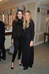 Left to right, YANA MAX and ASTRID HARBORD at the 3rd annual Gynaecological Cancer Fund Ladies Lunch at Fortnum & Mason, 181 Piccadilly, London on 29th September 2016.