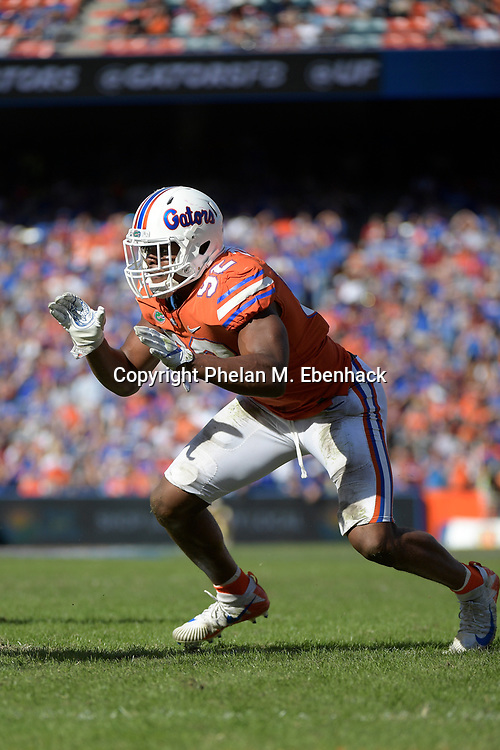 Florida defensive lineman Jabari Zuniga (92) rushes the line of scrimmage during the second half of an NCAA college football game against Florida State Saturday, Nov. 25, 2017, in Gainesville, Fla. FSU won 38-22. (Photo by Phelan M. Ebenhack)