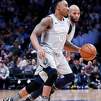 05 April 2018: Minnesota Timberwolves guard Jeff Teague (0) drives past Denver Nuggets guard Jamal Murray (27) on a screen set by Minnesota Timberwolves forward Taj Gibson (67) during the Denver Nuggets 100-96 victory over the Minnesota Timberwolves, at the Pepsi Center, Denver, Colorado, USA.