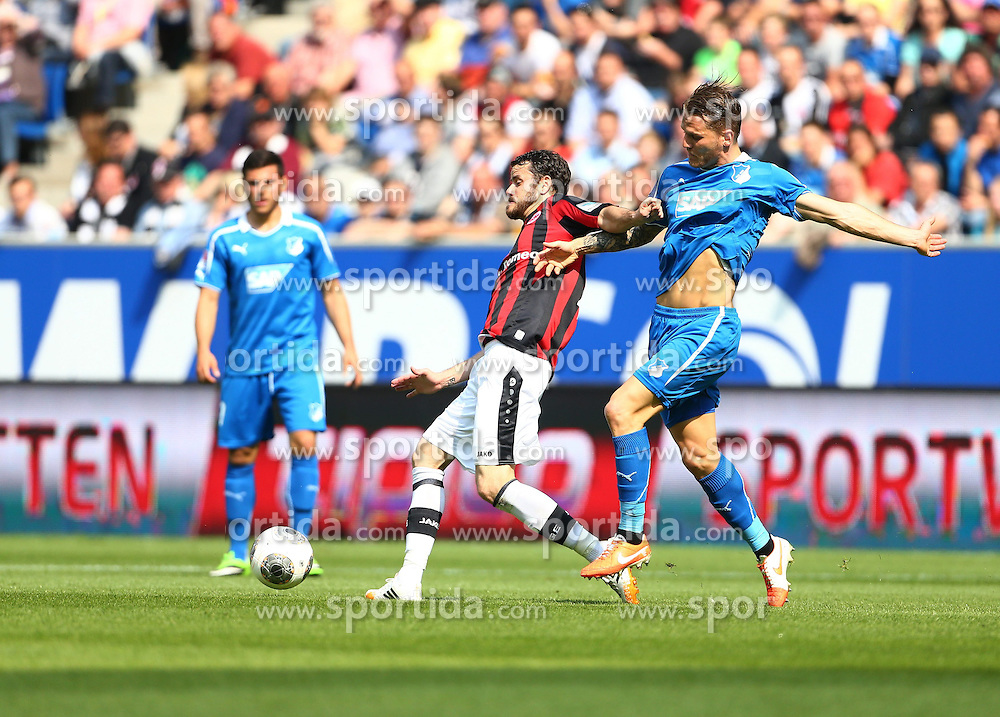26.04.2014, Rhein Neckar Arena, Sinsheim, GER, 1. FBL, TSG 1899 Hoffenheim vs Eintracht Frankfurt, 32. Runde, im Bild Tranquillo Barnetta (Eintracht Frankfurt) im Zweikampf mit Eugen Polanski (TSG 1899 Hoffenheim) // during the German Bundesliga 32th round match between TSG 1899 Hoffenheim and Eintracht Frankfurt at the Rhein Neckar Arena in Sinsheim, Germany on 2014/04/26. EXPA Pictures &copy; 2014, PhotoCredit: EXPA/ Eibner-Pressefoto/ Neis<br /> <br /> *****ATTENTION - OUT of GER*****