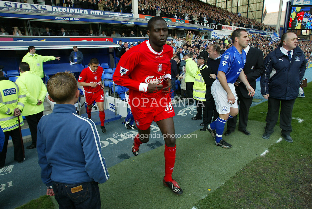 LIVERPOOL, ENGLAND - Saturday, April 19, 2003: Liverpool's Djimi Traore runs out to face Everton before the Merseyside Derby Premiership match at Goodison Park. (Pic by David Rawcliffe/Propaganda)