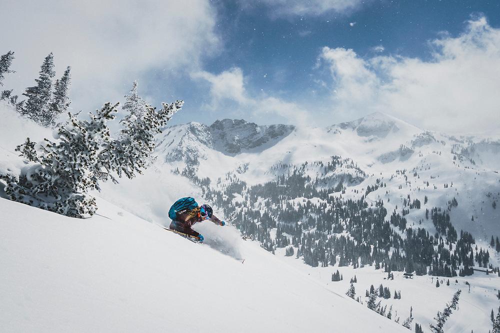 April showers bring late season powder days. Kaylin Richardson skiing deep in the spring swing of things, The Microwave, Alta, Utah.