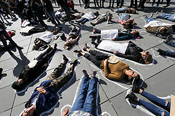 September 29, 2018 - Paris, Ile-de-France, France - Demonstrators take part in a Â« die-in » protest on the Place de la Republique square in Paris on September 29, 2018 during a gathering against gender-based and sexual violence called by the #NousToutes Collective, one year after the beginning of the #MeToo hashtag campaign, encouraging women to denounce experiences of sexual abuse that has swept across social media in the wake of the wave of allegations targeting Hollywood producer Harvey Weinstein. (Credit Image: © Michel Stoupak/NurPhoto/ZUMA Press)