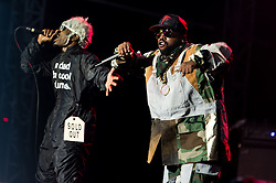 "© Licensed to London News Pictures. 05/09/2014. Isle of Wight, UK. Outkast performing live at Bestival 2014 Day 2 Friday.  In this picture - André ""André 3000"" Benjamin (left), Antwan ""Big Boi"" Patton (right).  Outkast are a hip hop duo consisting of rappers André ""André 3000"" Benjamin and Antwan ""Big Boi"" Patton.  This weekend's headliners include Chic featuring Nile Rodgers, Foals and Outcast.   Bestival is a four-day music festival held at the Robin Hill country park on the Isle of Wight, England. It has been held annually in late summer since 2004.    Photo credit : Richard Isaac/LNP"