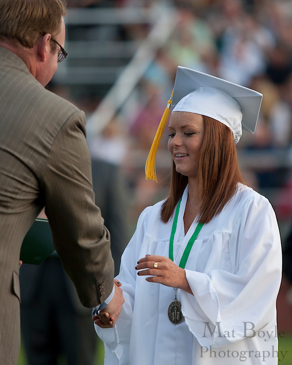 Courtney Elizabeth Cleary receives her diploma during Graduation.