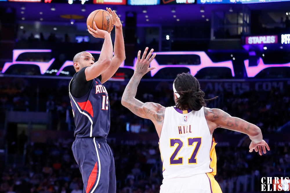 15 March 2015: Atlanta Hawks center Al Horford (15) takes a jump shot over Los Angeles Lakers center Jordan Hill (27) during the Atlanta Hawks 91-86 victory over the Los Angeles Lakers, at the Staples Center, Los Angeles, California, USA.