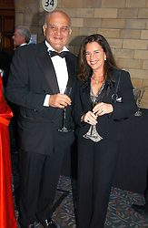 SIR MAGDI YACOUB and PROF.NADIA ROSENTHAL at a gala dinner in the presence of HM Quenn Silvia of Sweden and HM Queen Noor of Jordan in aid of the charity Mentor held at the Natural History Museum, Cromwell Road, London on 23rd May 2006.<br />