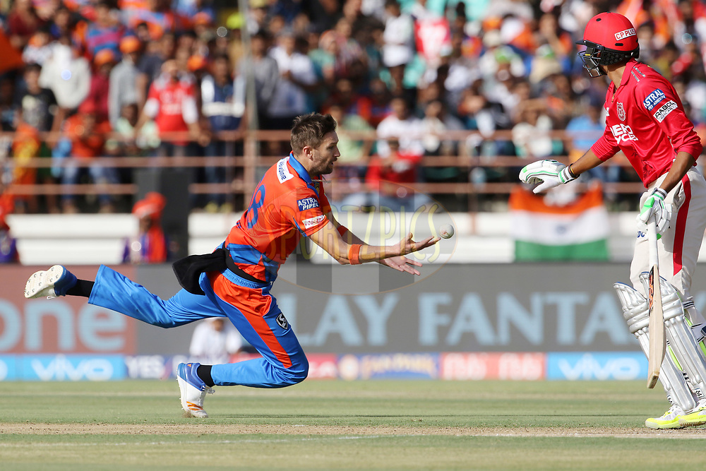 Andrew Tye of the Gujarat Lions tries to take the catch of Marcus Stoinis of Kings XI Punjab during match 26 of the Vivo 2017 Indian Premier League between the Gujarat Lions and the Kings XI Punjab held at the Saurashtra Cricket Association Stadium in Rajkot, India on the 23rd April 2017<br /> <br /> Photo by Vipin Pawar - Sportzpics - IPL