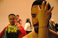 Actor Juan Ponce, 27, takes on the image of Jesus Christ as he prepares to reenact the 14 Stages of the Cross during a Via Crucis procession at St. Jerome Catholic Parish in Chicago's Rogers Park neighborhood. The biblical re-enactment portrays the story of Christ being condemned to death, followed by his crucifixion and entombment.