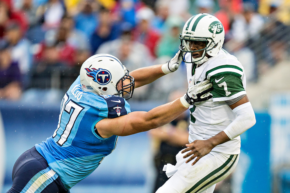 NASHVILLE, TN - SEPTEMBER 29:  Geno Smith #7 of the New York Jets tries to get away from Karl Klug #97 of the Tennessee Titans at LP Field on September 29, 2013 in Nashville, Tennessee.  The Titans defeated the Jets 38-13.  (Photo by Wesley Hitt/Getty Images) *** Local Caption *** Geno Smith; Karl Klug