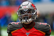 The Tottenham Stadium lights are reflected in the Visor of Tampa Bay Buccaneers Running Back T. J. Logan (22) during the International Series match between Tampa Bay Buccaneers and Carolina Panthers at Tottenham Hotspur Stadium, London, United Kingdom on 13 October 2019.
