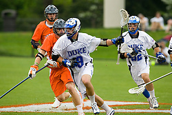 Duke midfielder Michael Ward (9) in action against UVA.  The #2 ranked Duke Blue Devils defeated the #3 ranked Virginia Cavaliers 11-9 in the finals of the Men's 2008 Atlantic Coast Conference tournament at the University of Virginia's Klockner Stadium in Charlottesville, VA on April 27, 2008.