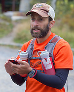Cragsmoor, New York - Jason Friedman of New Paltz listens to pre-race instructions at Sam's Point Preserve before competing in the Shawangunk Ridge Trail Run/Hike 32-mile race on Sept. 20, 2014.