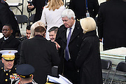 Former House Speaker Newt Gingrich and his wife Callista Gingrich chat with American casino magnate Sheldon Adelson before the start of the Inauguration of President-elect Donald Trump as the 45th President on Capitol Hill January 20, 2017 in Washington, DC.