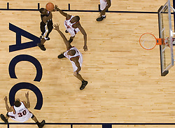 Virginia's Mamadi Diane (24) rejects a shot by Wake Forest's Harvey Hale (4) in the second half.  The Virginia Cavaliers defeated the Wake Forest Demon Decons 88-76 at the John Paul Jones Arena in Charlottesville, VA on January 21, 2007.