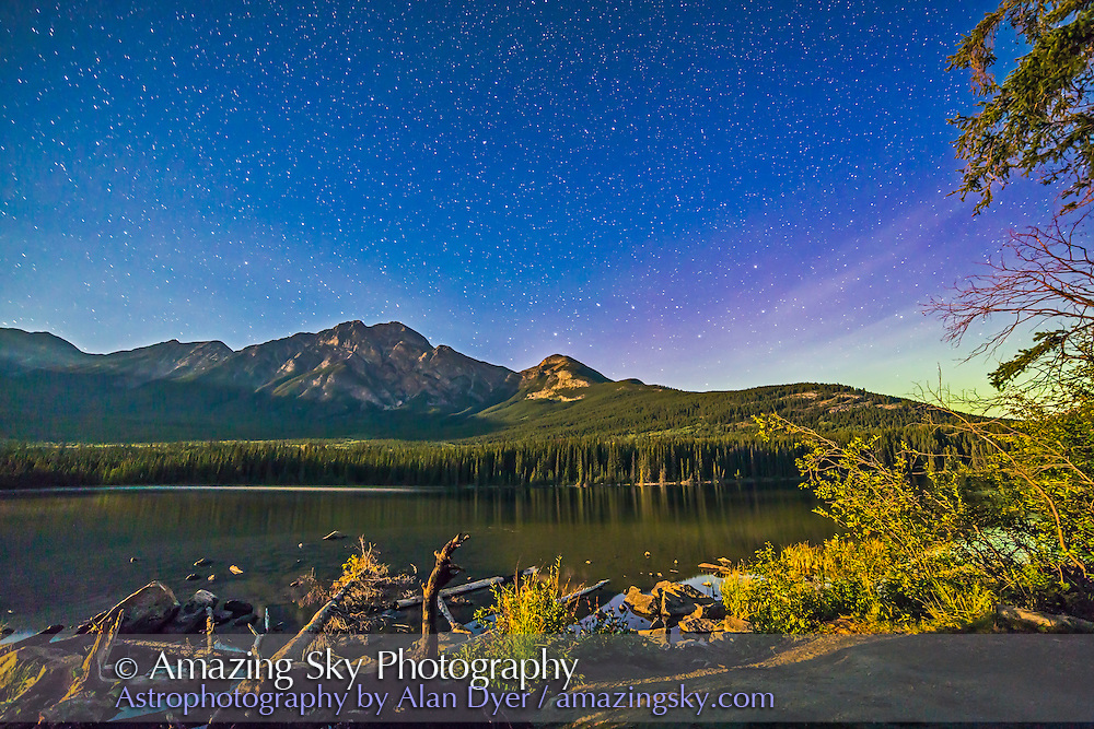 Pyramid Mountain and the Big Dipper, shot from Pyramid Island looking north, in Jasper National Park, Alberta. Illumination is from the setting waxing gibbous Moon off camera to the left. Some faint aurora is to the right. This is a single 45-second exposure with the 14mm Rokinon lens at f/2.8 and Canon 6D at ISO 2000.
