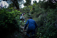A group of refugees from Afghanistan climbing the hills between Italy and France on the 'Passo della Morte'. Ventimiglia, Italy. April 2017. Federico Scoppa