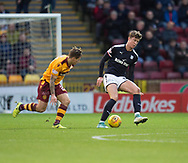 23rd December 2017, Fir Park, Motherwell, Dundee; Scottish Premier League football, Motherwell versus Dundee; Dundee's Jack Hendry and Motherwell's Craig Tanner