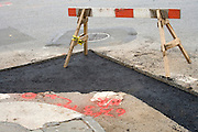street repair after opening up the road to add piping