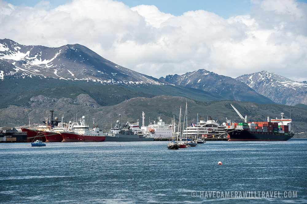 A variety of commercial, cruise, and naval ships docked at Puerto de Ushuaia, Argentina.