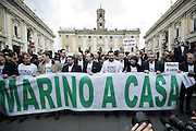 Roma 25th feb 2015, leader and parliamentarians of Lega Nord party, demonstrates at Campidoglio's Square, demanding the resignation of mayor of Rome. In the picture Matteo Salvini and other parlamentarians, holds a sign reading ' Marino go home '