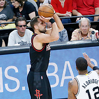 01 May 2017: Houston Rockets forward Ryan Anderson (3) takes a jump shot over San Antonio Spurs forward LaMarcus Aldridge (12) during the Houston Rockets 126-99 victory over the San Antonio Spurs, in game 1 of the Western Conference Semi Finals, at the AT&T Center, San Antonio, Texas, USA.
