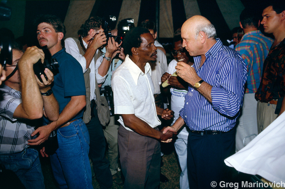 President FW de Klerk meets a black voter during a campaign visit ahead of the first non racial elections in South Africa, 1994.