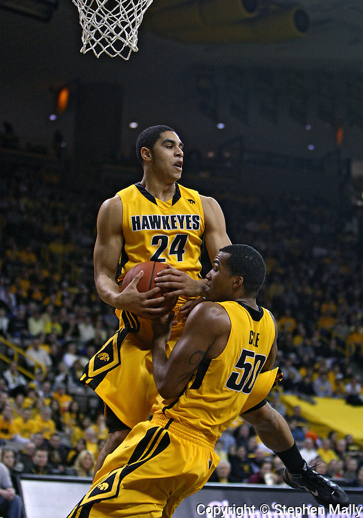 January 27, 2010: Iowa forward Aaron Fuller (24) and Iowa forward Jarryd Cole (50) bring down a rebound during the first half of their game at Carver-Hawkeye Arena in Iowa City, Iowa on January 27, 2010. Ohio State defeated Iowa 65-57.