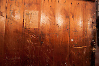 Writings on the door in Youssef's barn dates back to the early 1900's.  (Karen Bobotas/for the Laconia Daily Sun)