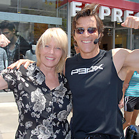 President/CEO of the Santa Monica Chamber of Commerce Laurel Rosen and Fitness Trainer and Creator of P90X Tony Horton pose during the Santa Monica Chamber of Commerce's 26th Annual Health and Fitness Festival at the Third Street Promenade on Saturday, July 30, 2011.