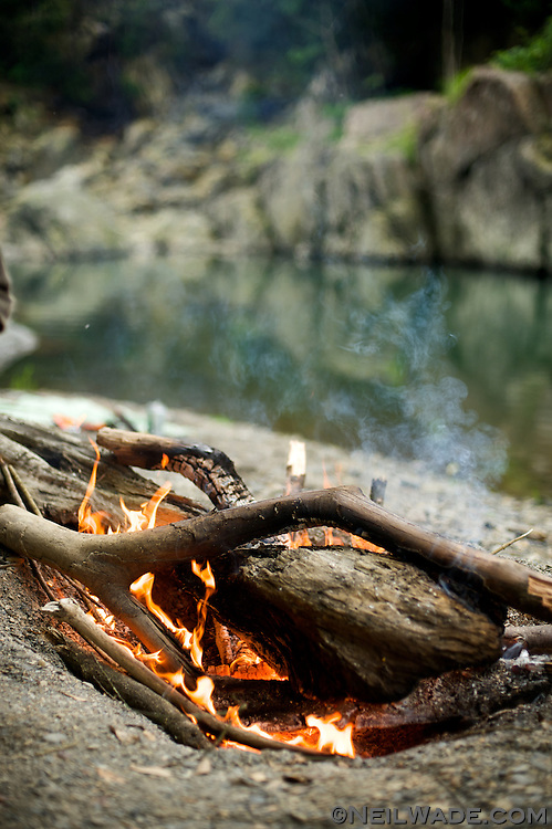 A campfire on the shore of a river near Wulai, Taiwan.