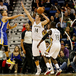 Nov 26, 2013; New Orleans, LA, USA; Golden State Warriors point guard Stephen Curry (30) passes the ball as New Orleans Pelicans center Jason Smith (14) defends during the first quarter of a game at New Orleans Arena. Mandatory Credit: Derick E. Hingle-USA TODAY Sports