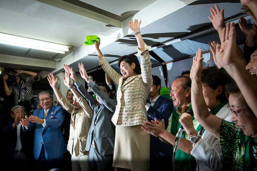 TOKYO, JAPAN - JULY 31 : Yuriko Koike, newly elected governor of Tokyo, center, celebrates after she speaks during a news conference after winning the Tokyo gubernatorial election at her office in Tokyo, Japan, on Sunday, July 31, 2016. Yuriko Koike a Liberal Democratic Party lawmaker and former defense minister is the first women to be elected as a Governor of Tokyo. (Photo: Richard Atrero de Guzman/NURPhoto)