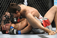 "LAS VEGAS, NEVADA, MAY 24, 2008: Dong Hyun Kim (top) pressures a grounded Jason Tan during ""UFC 84: Ill Will"" inside the MGM Grand Garden Arena in Las Vegas"