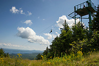 Members of the Future In Sight group (formerly NH Association of the Blind) enjoyed a beautiful day zip lining from the top of Gunstock Mountain Thursday afternoon.  (Karen Bobotas/for the Laconia Daily Sun)