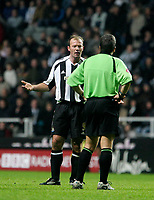 Photo: Andrew Unwin.<br />Newcastle Utd v Aston Villa. The Barclays Premiership.<br />03/12/2005.<br />Newcastle's Alan Shearer (L) argues with the referee, Alan Wiley (R).