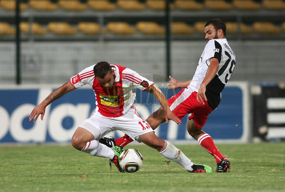 CAPE TOWN, SOUTH AFRICA - 2 February 2010, Lance Davids of Ajax is fouled by Dillon Sheppard of Platinum Stars  during the Absa Premiership match between Ajax Cape Town and Platinum Stars held at Athlone Stadium in Cape Town, South Africa..Photo by: Shaun Roy/Sportzpics